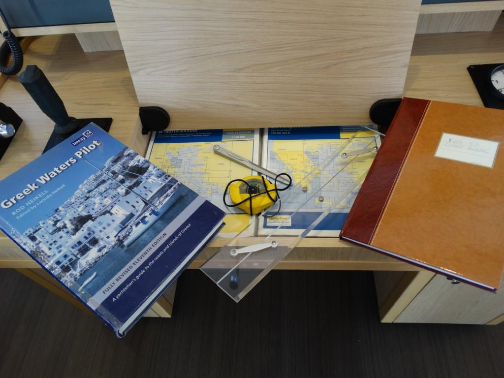 09 greek water pilot,maps,handbearing compas,navigation ruler, divider, logbook